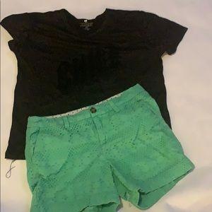 Small black shirt  .& size 2 green shorts
